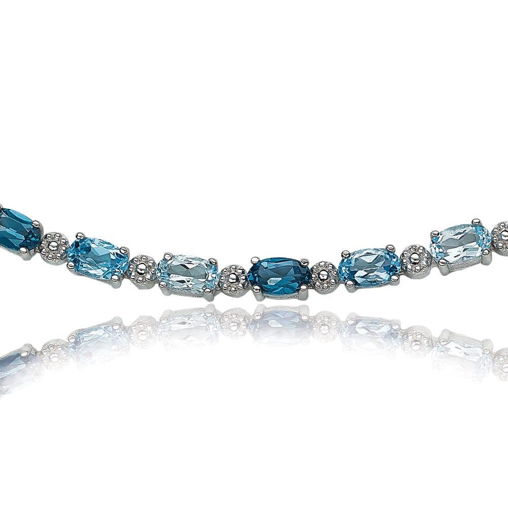 Oval Blue Topaz Birthstone Bracelet in Sterling Silver
