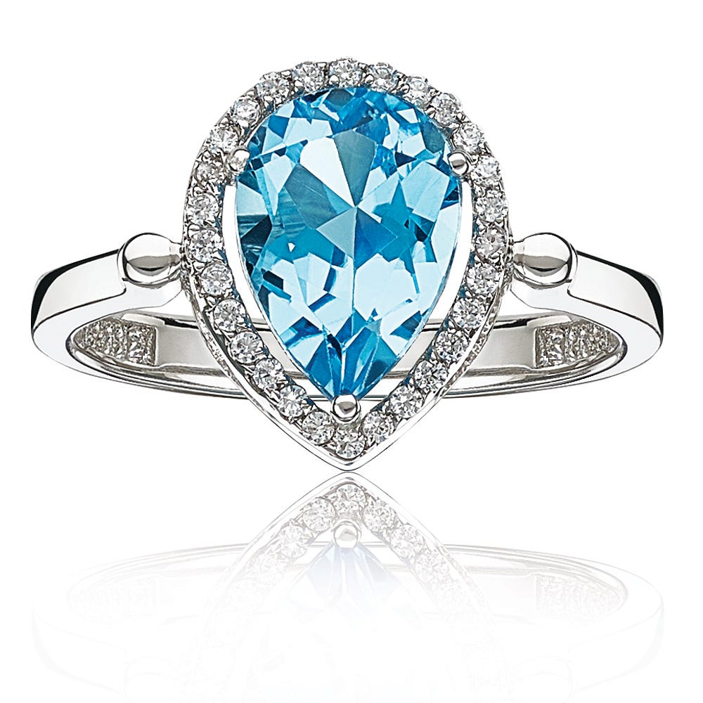 Pear Blue Topaz & Diamond Halo Ring in Sterling Silver