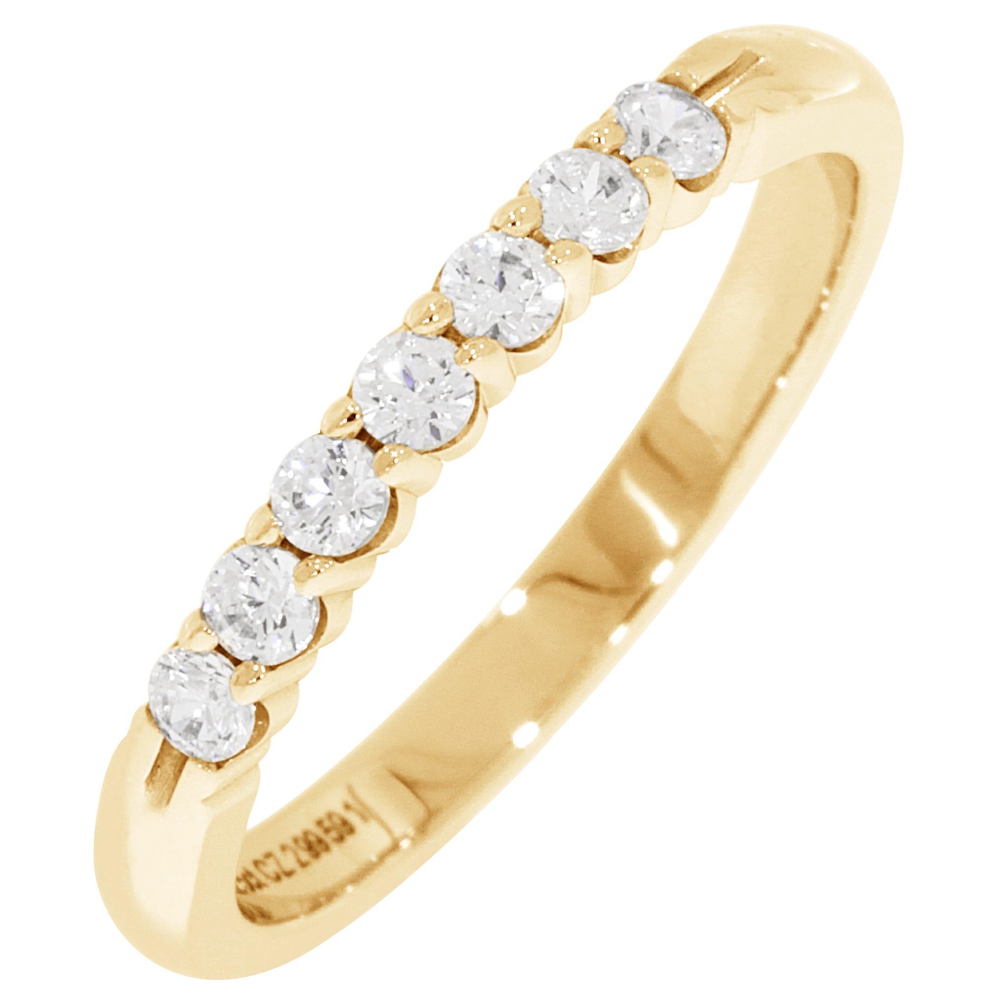 Ladies' 7-Stone 1/4ctw. Diamond Wedding Band in 14K Yellow Gold (HI, I1-I2)