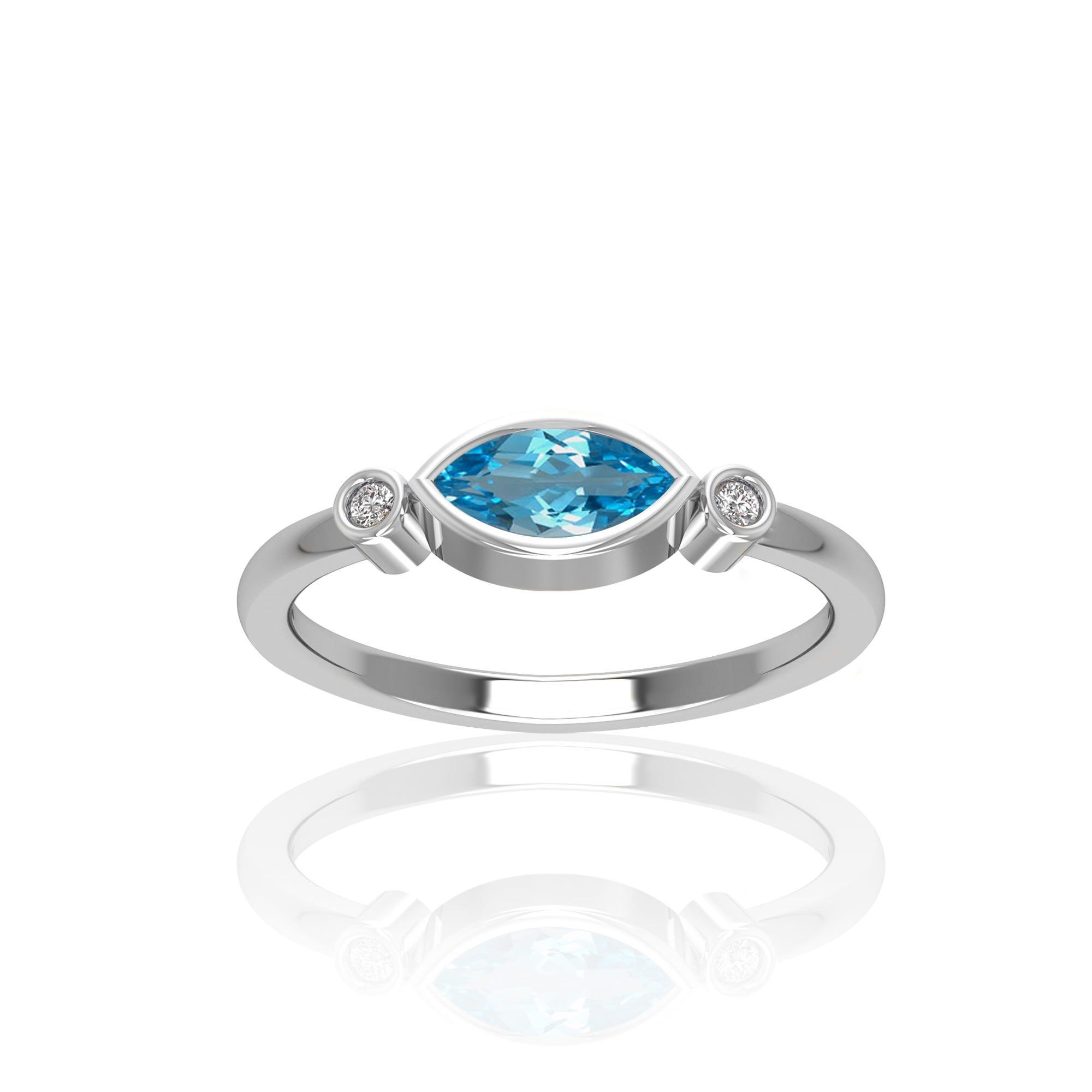 Marquise Shape Blue Topaz & Diamond Ring in 10k White