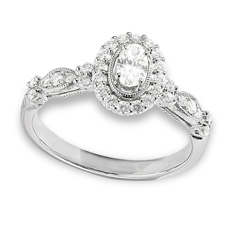 Angelina. Classic Elegance Oval Halo Engagement Ring 5/8ctw. In 14k White Gold