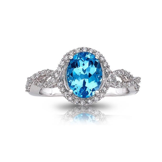 Oval Blue Topaz & Diamond Halo Ring in 10k White Gold